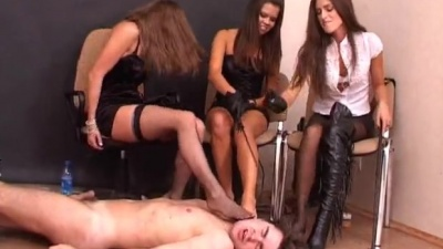 Foot slave on the floor flogged & sucking toes of 3 mistress