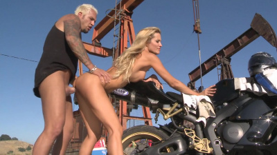 Hot babe Jessica Drake has sex with biker in the desert