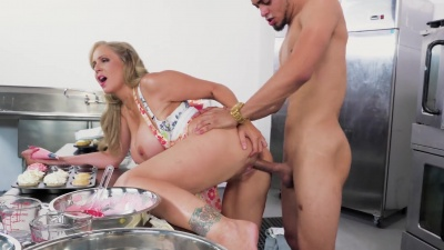 Milf Julia Ann lets her young employee fuck her on the kitchen table
